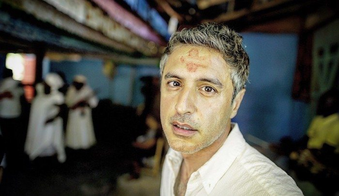 Evil Comes to dinner - Reza Aslan displays cannibalism shows off eating human brains