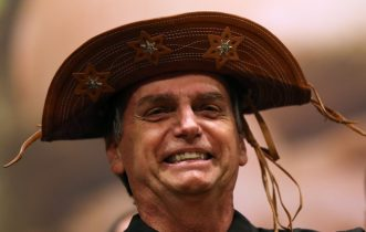 Brazil's leading candidate Bolsonaro confirms Guedes would be economy minister