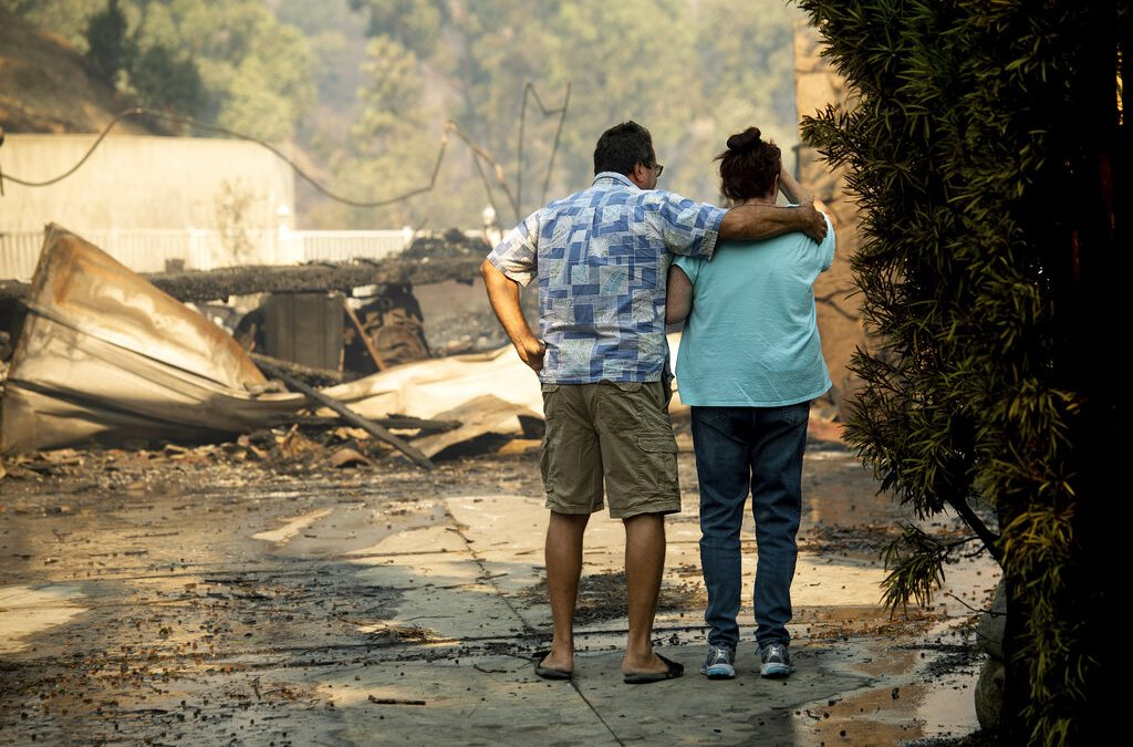 Fires ravage California as utility companies plan power outages